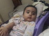 Two-year-old Mohammad Ahsan Shaikh was travelling in a rickshaw with his parents when a bullet hit him. PHOTO: EXPRESS