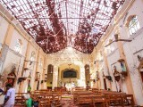 Sri Lankan officials inspect St. Sebastian's Church in Negombo, north of Colombo, after multiple explosions targeting churches and hotels across Sri Lanka on April 21, 2019. PHOTO: AFP