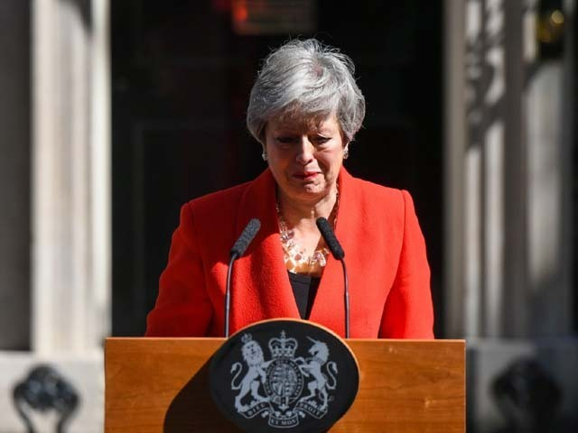 Theresa May reacts as she delivers a speech announcing her resignation. PHOTO: GETTY