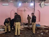 Pakistani police officials examine the interior of a mosque after a blast on the outskirts of Quetta on May 24, 2019. PHOTO: AFP