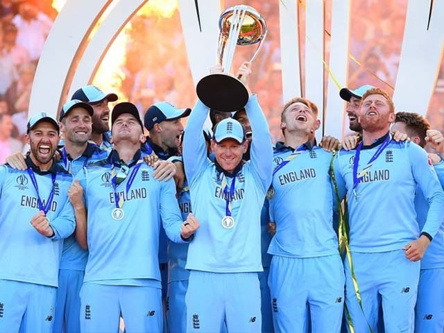 England's Eoin Morgan celebrates with his team as he lifts the 2019 Cricket World Cup trophy. PHOTO: GETTY