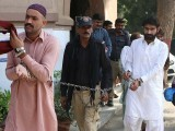 This photograph taken on October 17, 2017, shows Wasim (R), brother of slain social media celebrity Qandeel Baloch and his cousin, who are accused of killing her, are escorted by policeman as they arrive at a local court in Multan. PHOTO: AFP