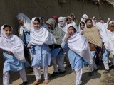 Afghan refugees walk home from school at a refugee camp in Haripur. PHOTO: AFP