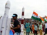 Students wave Indian national flags as the Indian Space Research Organisation (ISRO). PHOTO: AFP