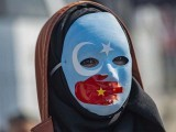 A demonstrator joins supporters of China's Muslim Uighur minority and during a anti-China protest. PHOTO: GETTY