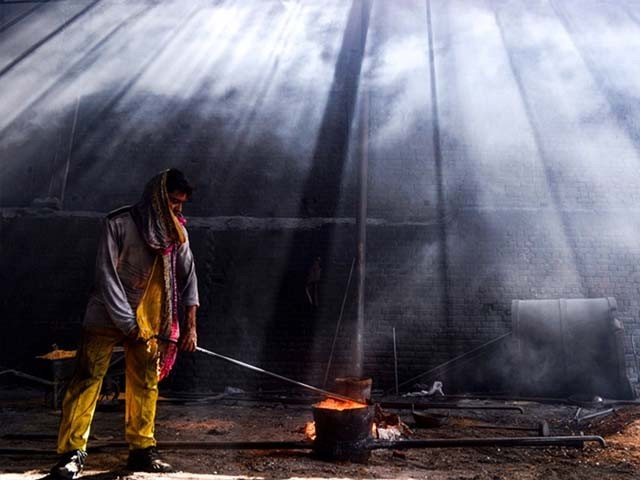 A Pakistani labourer working at an iron factory. PHOTO: AFP