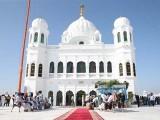 Sikh pilgrims gather to offer prayers towards the Temple of Baba Guru Nanak Dev. PHOTO: GETTY