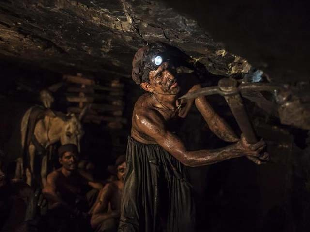 Miner Mohammad Ismail, 25, digs in a coal mine in Choa Saidan Shah. PHOTO: REUTERS