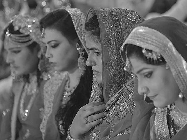 Pakistani brides attend a mass-wedding ceremony in Karachi. PHOTO: GETTY