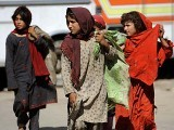 Pakistani girls walk with sacks filled with scavenged garbage in Islamabad. PHOTO: GETTY