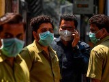 People wearing face masks in India amid concerns over the spread of the COVID-19. PHOTO: GETTY