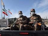 Pakistani soldiers wearing face masks patrol near the Pakistan-Iran border. PHOTO: GETTY