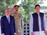 Visiting Afghan President Ashraf Ghani and Prime Minister Imran Khan review an honour guard. PHOTO: AFP